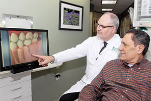 Doctor answers all questions of dental implants.